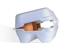 Eggs on a box. The brown eggs in a white carton box Royalty Free Stock Images