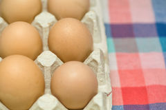 Eggs at the box Stock Images
