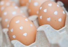 Eggs at the box Stock Photos