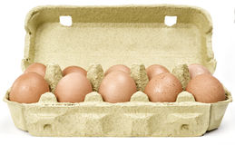 10 еggs in cardboard. Eggs in a cardboard box on isolated background Stock Photo