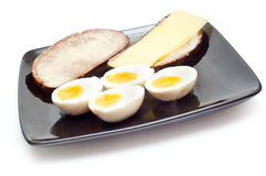 Eggs and bread with butter Stock Photography