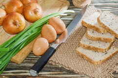 Eggs, bread, cereal and other vegetables on wooden background Royalty Free Stock Image