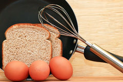 Eggs, Bread and Frying Pan Stock Images