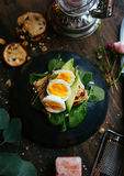 Eggs on bread and leaves
