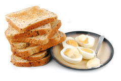 Eggs and bread slices Stock Photography