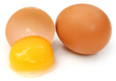 Eggs broken with yolk Stock Images