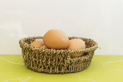 Eggs in a brown Basket stock photo