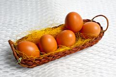 Eggs of brown chicken in a basket on a white background for Easter Royalty Free Stock Photography