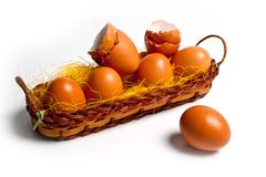 Eggs of brown chicken in a basket on a white background for Easter Royalty Free Stock Photo