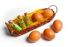 Eggs of brown chicken in a basket on a white background for Easter Stock Photo
