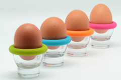 Eggs browns. Some brown eggs in egg cups Royalty Free Stock Images