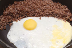 Eggs with buckwheat on fruing pan closeup Royalty Free Stock Photography
