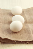 Eggs on burlap background Royalty Free Stock Photo