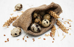 Eggs in a burlap bag. On a old wooden background Royalty Free Stock Photo