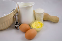 Eggs butter dairy products and baking ingredient. Staples of the kitchen, eggs, milk, and butter. Dairy products and baking ingredient Stock Photography