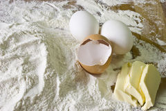 Eggs, butter and flour Stock Images