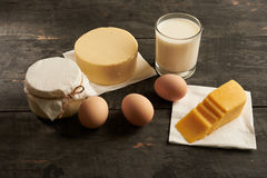 Eggs, butter, milk, sour cream on the table. Eggs, butter, milk, sour cream on the wooden table Royalty Free Stock Image