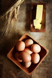 Eggs with butter and wheat Stock Photography