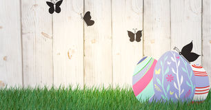 Eggs with butterfly in the garden. Happy Easter. Royalty Free Stock Image