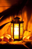 Eggs and a candle lantern Stock Photo