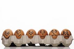 Eggs caracteres sobre el fondo blanco Foto de archivo