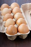 Eggs in a cardboard box. On a dark surface Royalty Free Stock Images