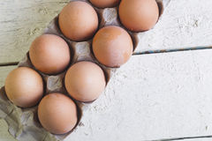 Eggs in a cardboard tray on a white boards. Stock Photography