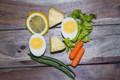 Eggs with carrots and green beans. Healthy foods Royalty Free Stock Photo