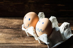 Eggs in carton box on wooden background Stock Photo