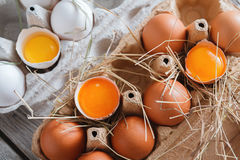 Eggs carton. Healthy food background. Yellow yolk Stock Photos