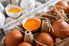 Eggs carton. Healthy food background. Yellow yolk Royalty Free Stock Images
