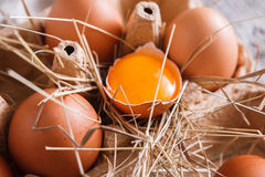 Eggs carton. Healthy food background. Yellow yolk Royalty Free Stock Image