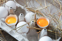 Eggs carton. Healthy food background. Yellow yolk Royalty Free Stock Photography