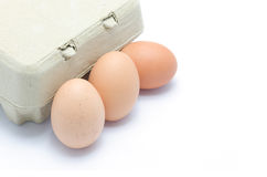 Eggs and carton package Stock Photos