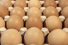 Eggs in carton package on a wooden table for baking, close up Royalty Free Stock Photo