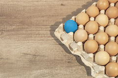 Eggs in carton package on a wooden table ready for baking Royalty Free Stock Photography