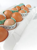 Eggs in Carton with Tape Measure 2 Royalty Free Stock Photo