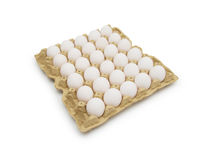 Eggs in carton on white with clipping path. Isolated Stock Photography