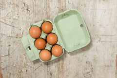 Eggs in a Carton on a Wooden Surface Stock Photography