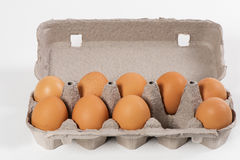 Eggs. With cartoon box and isolated background Royalty Free Stock Photography