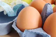 Eggs in cartoon package closed up. Brown fresh eggs in blue cartoon package closd up Stock Photo