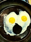 Eggs in cast iron pan stock image