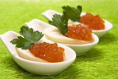 Eggs with caviar Stock Images