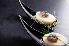 Eggs with caviar. Royalty Free Stock Images