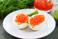 Eggs and caviar on white saucer Stock Image