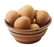 Eggs in a ceramic bowl. Isolated on white Stock Photography