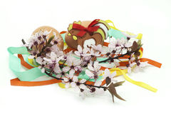 Eggs with ceramic cock, blossom and ribbons. Eggs with decorated ceramic cock, blossom and ribbons Stock Photo