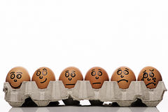 Eggs characters over white background. Pain intensity scale concept with copyspace and eggs characters over white background Stock Photo