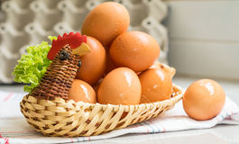 Eggs in a chicken basket Stock Images
