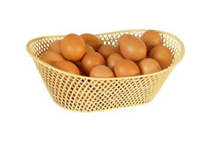 Eggs chicken in basket isolated on white background Royalty Free Stock Photos